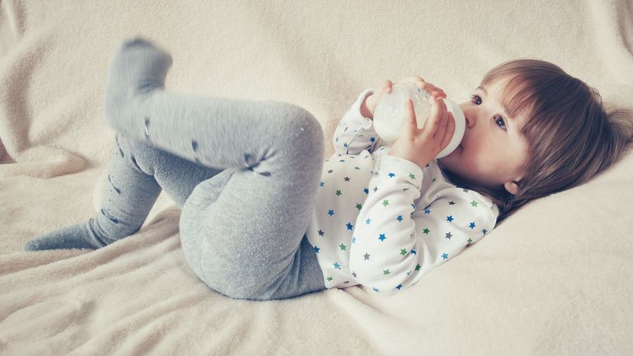 Baby Girl Toddler  Childhood Drink Drinking Milk Bottle Holding Hands Herself Laying Down Relaxed Content Kid Kids Being Kids Kids Photography Kids Kids Portrait Kids Of EyeEm Learning By Doing Learning