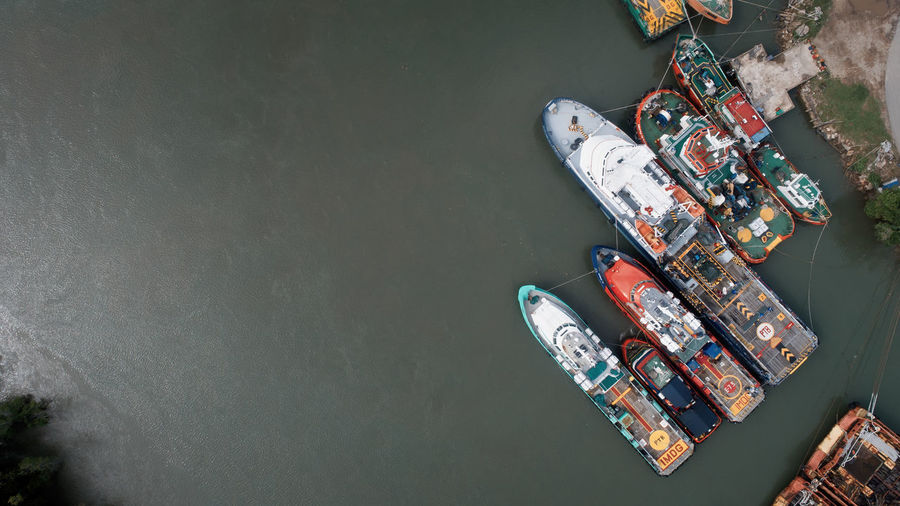 High angle view of boat floating on river