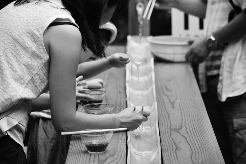Slurp The Sliding Somen - this is next level Food On The Go . Somen noodles sliding down bamboo, deftly picked up by standing diners and dipped in sauce, only in Japan. EyeEm Best Shots Streetphoto_bw Japan