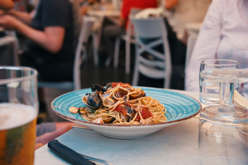Seafood with pasta on the table in restaurant