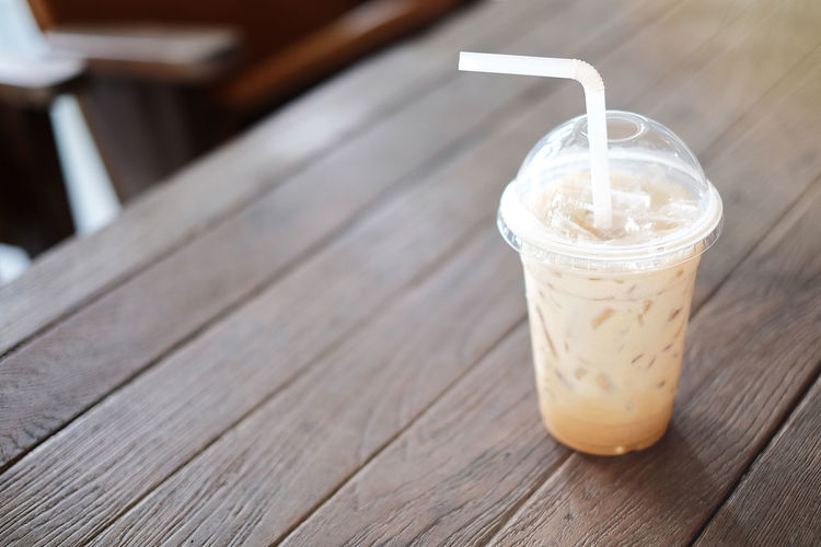 Ice Close-up Coffee Coffee - Drink Disposable Disposable Cup Drink Drinking Glass Drinking Straw Focus On Foreground Food Food And Drink Freshness Glass Household Equipment Ice Coffee Icelatte Latte No People Non-alcoholic Beverage Refreshment Still Life Straw Table Wood - Material