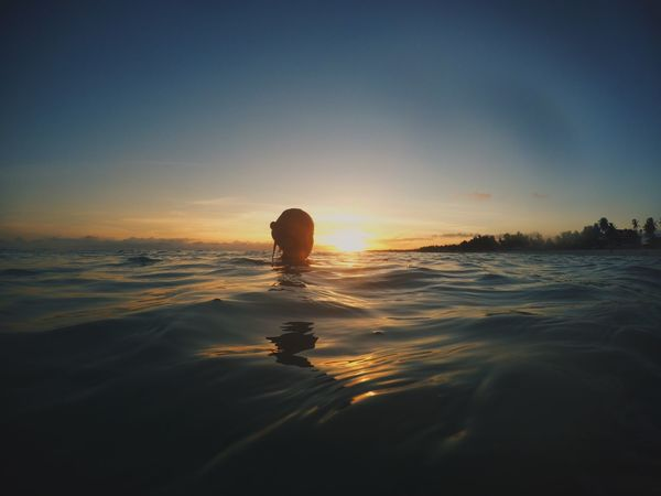 Blessed! Water Sea Sunset Nature Waterfront Beauty In Nature Sky Outdoors Leisure Activity Real People Swimming Beach One Person Day