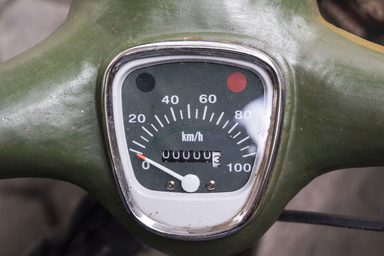 Close-up of speedometer on motor scooter