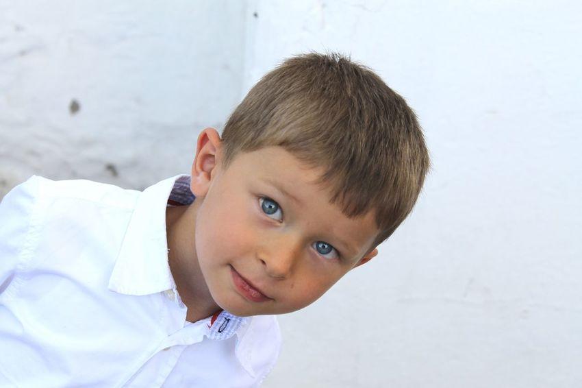 Childhood Leisure Activity Lifestyles Innocence Headshot Cute Elementary Age Toddler  Person Focus On Foreground White Background Shirt Boy Blonde Blondehair BlueEyes Turkey