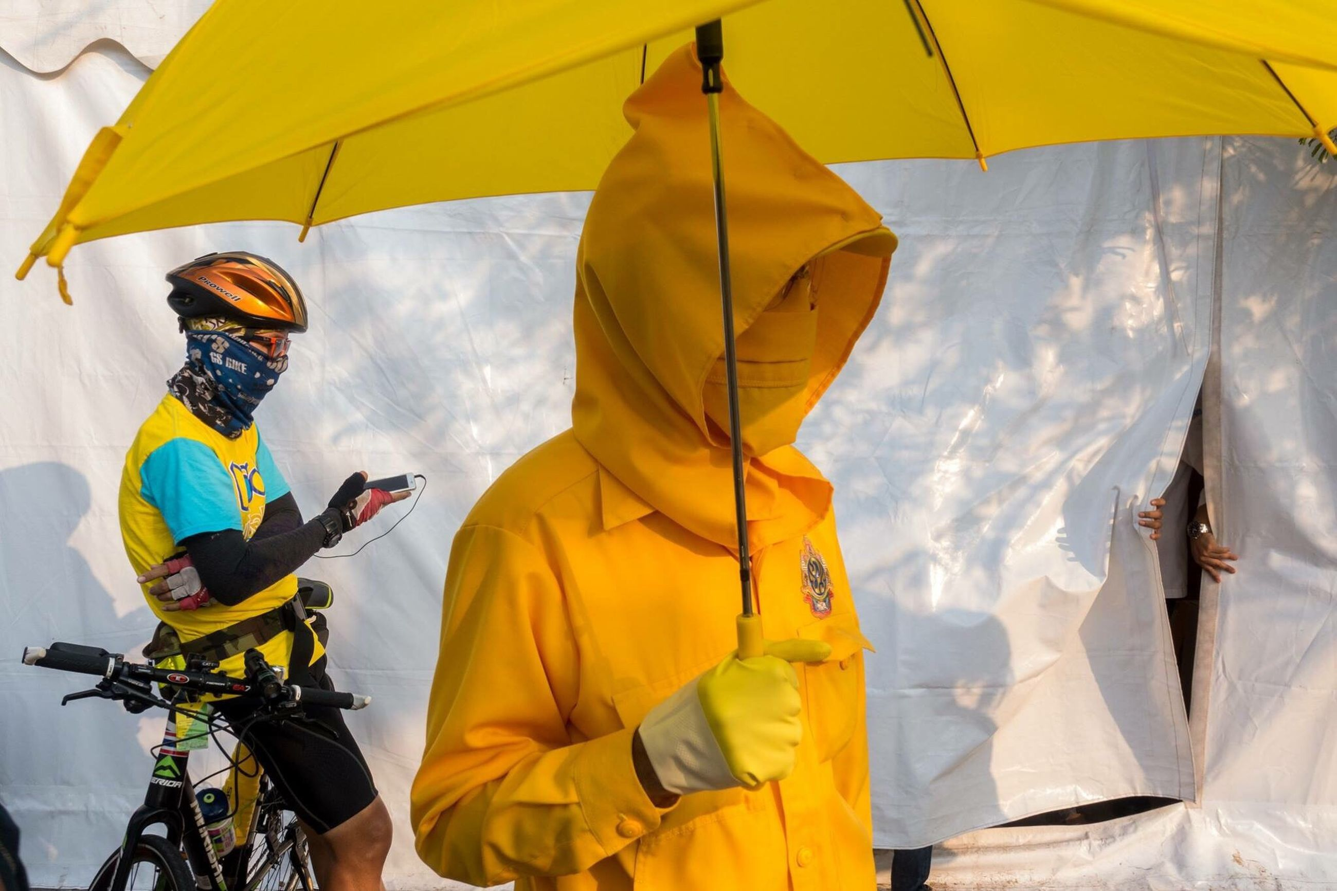 lifestyles, men, leisure activity, yellow, umbrella, adventure, low angle view, casual clothing, person, sky, holding, travel, hanging, fun, day, rear view, multi colored