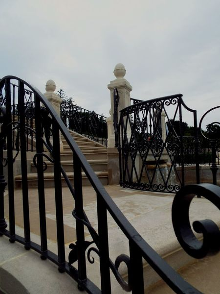 Railing Metal Wrought Iron Built Structure No People Outdoors Day Clouds Staircase Garden LongwoodGardens