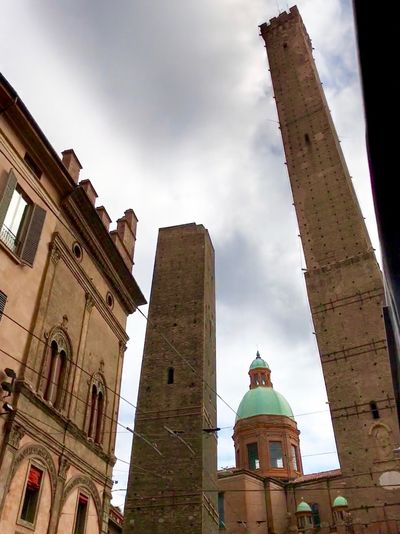 Power and towers... Architecture Torre Degli Asinelli Towers And Sky Towers City Street Old Town Square Historical Monuments Garisenda in Bolonha, Italy