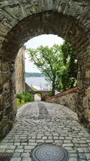 Narrow walkway leading to archway