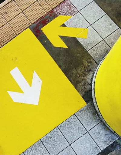 Here, There | Yellow Communication Guidance Triangle Shape Day No People Outdoors Road Sign Multi Colored Close-up Abstract Arrows Sign Station Train Station Metro Rail