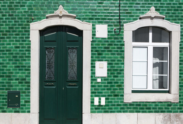 Built Structure Building Exterior Architecture Window Building Day No People Closed Wall - Building Feature Door Entrance Wall Green Color Outdoors House Brick Wall Glass - Material Residential District Sunlight Brick Turquoise Colored