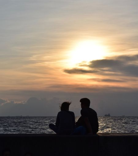 Sunset Togetherness Two People Sea Water Love Bonding Sky Silhouette Beach Nature Beauty In Nature Men Real People Sitting Scenics Horizon Over Water Leisure Activity Cloud - Sky Lifestyles Be. Ready. EyeEmNewHere Be. Ready. This Is Masculinity The Traveler - 2018 EyeEm Awards The Street Photographer - 2018 EyeEm Awards #urbanana: The Urban Playground Summer In The City