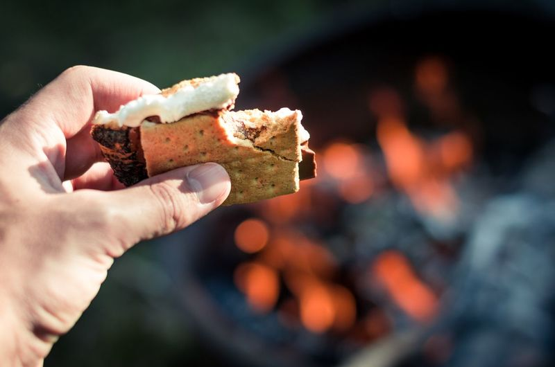 S'mores 🔥 Human Hand Food And Drink Focus On Foreground Real People Food Holding Human Body Part Freshness One Person Dessert Day Sweet Food Outdoors Close-up Ready-to-eat People Autumn Fall Fire Smores S'mores Marshmallows Campfire Dessert Eaten