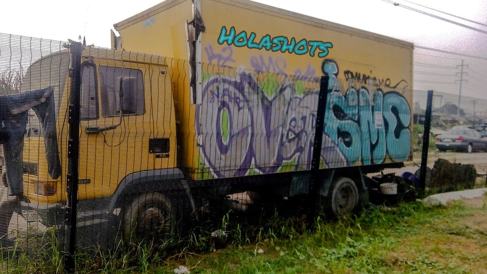 Mode Of Transport Outdoors Land Vehicle Built Structure No People Day Sky Architecture First Eyeem Photo Transportation Front View City Composition Holashots Free Edit Metal Industry Passion Looking At Camera Full Length graffiti