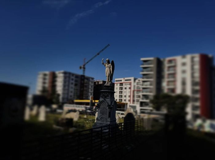 The Angels are coming for you EyeEm Ready   Grave Graveyard Angel Statue Blue Modernity Architecture No People Day Outdoors Sky City EyeEmNewHere