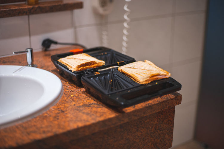 High angle view of a sandwich maker on table