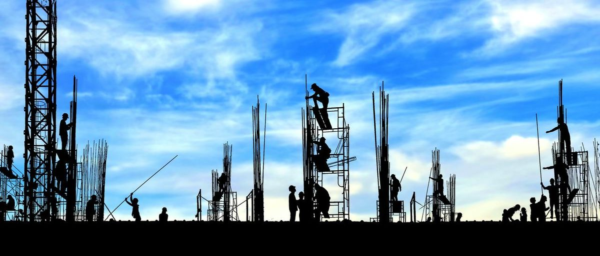 Silhouette construction workers group are working to build reinforcement structure on top of building in construction site with blurred clouds and blue sky background, panorama view Working Reinforcement Engineer Engineering Profession Shadow Blur Background Clouds And Blue Sky Group Technology Panorama View Construction Industrial Outdoor Crane Equipments Tools Occupation Structure Scaffolding Silhouette Sky Cloud - Sky Office Building Tall - High Construction Site Incomplete Building Construction Worker Construction Frame
