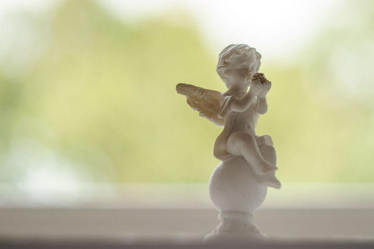 Figurine Of Cherub On Window Sill