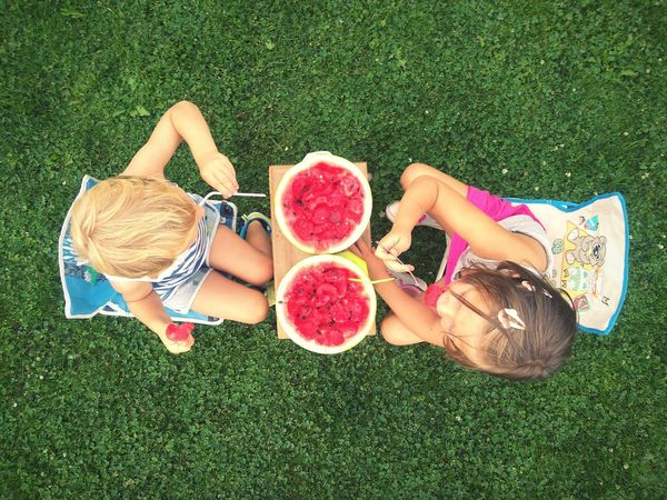 Two Kids Eating Watermelon Fruit Photography Fruits Summer Season Chilling Childhood Fresh Fruits Freshness High Angle View Snack Time! Outdoors Lifestyles Directly Above Fruit Full Length Green Color Breathing Space The Week On EyeEm Mix Yourself A Good Time