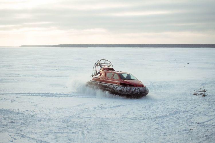 Hovercraft On Snow Against Sky