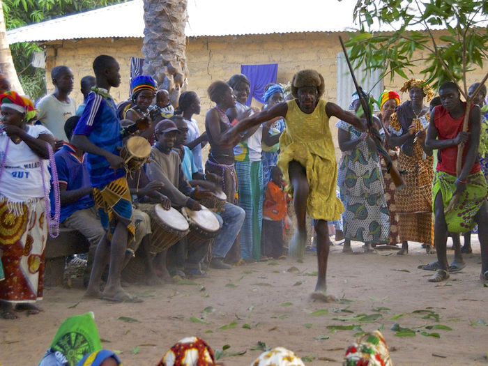 African circumcision ceremony when the boys come back as men out of the woods. In Niafrang, Senegal. African Circumcision Ceremony Dancing Niafarang Niafourang Niafrang Traditional Culture West Africa Africa African Ceremony Casamance Ceremony Circumcision Day Enjoyment Kankouran Kankourang Outdoors Traditional