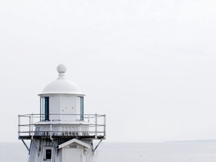 Lighthouse on a Swedish Island Ancient Architecture Blekinge Day Haze Historic Horizon Horizon Over Water Island Lighthouse Lighthouses Maritime Monochrome Nature No People Old Old Buildings Outdoors Sky Summer Sweden Swedish Tranquil Scene Tranquility Water