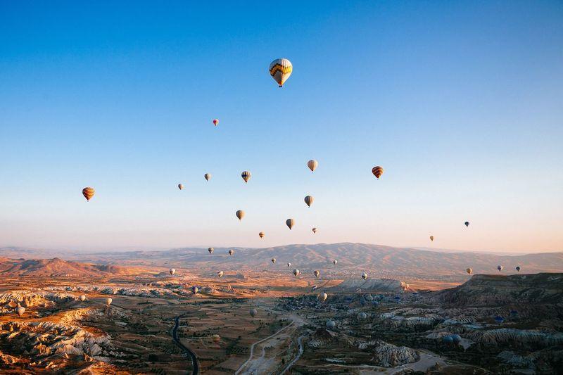 Hot air balloons at cappadocia against sky