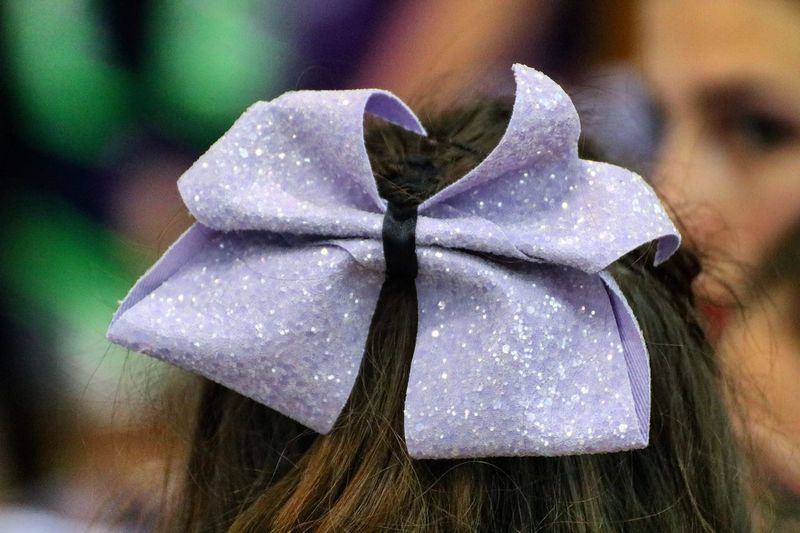 Close-up of purple hair bow on woman head