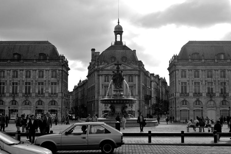 People by fountain at place de la bourse