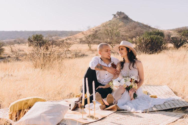 Couple sitting on land
