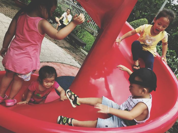 Lets play Girls Childhood Real People Elementary Age Leisure Activity Lifestyles Fun Happiness Family Togetherness Mother Sibling Boys Casual Clothing Sitting Daughter Smiling Love Cute Bonding Children Playing Yard Day Park Kids EyeEmNewHere Second Acts
