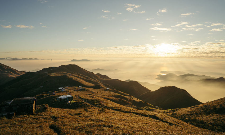Sunrise of Sunset Peak in Hong Kong Sky Mountain Beauty In Nature Cloud - Sky Scenics - Nature Sunset Tranquil Scene Tranquility Mountain Range Environment Nature Sun Landscape Sunlight Non-urban Scene Idyllic No People Sunbeam Outdoors Orange Color Lens Flare Bright Mountain Peak 2018 In One Photograph