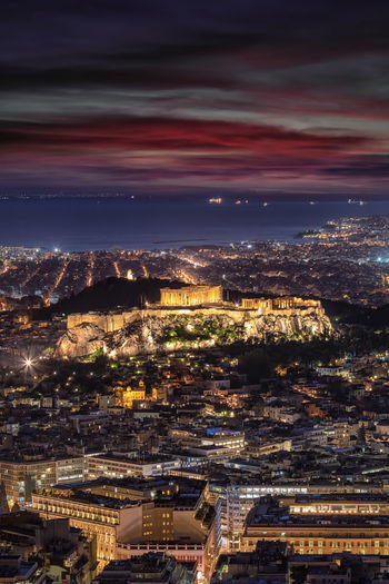 The illuminated Parthenon Temple of the Acropolis of Athens, Greece, just after sunset Cityscape Building Exterior Architecture City Built Structure Illuminated High Angle View Sky Aerial View Night City Life Outdoors Athens Greek Oldtown Acropolis Parthenon Ruins Temple Lights Skyline Cityscape Travel Destinations Tourist Attraction  Landmark