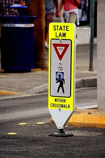 Pedestrian Crossing Sign On Roadside