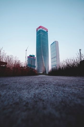 Architecture Built Structure Sky Building Exterior City Building Nature Skyscraper Surface Level Outdoors Modern Day Financial District  Office Building Exterior Low Angle View Tall - High No People Tower Clear Sky Water