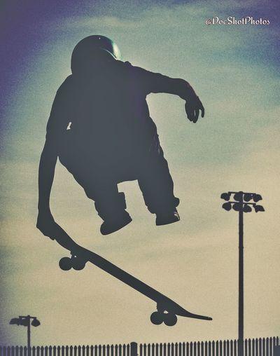 Silhouette man skateboarding on skateboard against sky