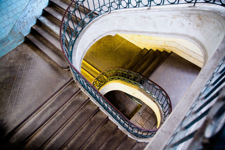 Architecture Blue Light Building Built Structure Day Design Directly Above High Angle View History Indoors  Metal No People Pattern Railing Spiral Spiral Staircase Staircase Steps And Staircases Yellow Light