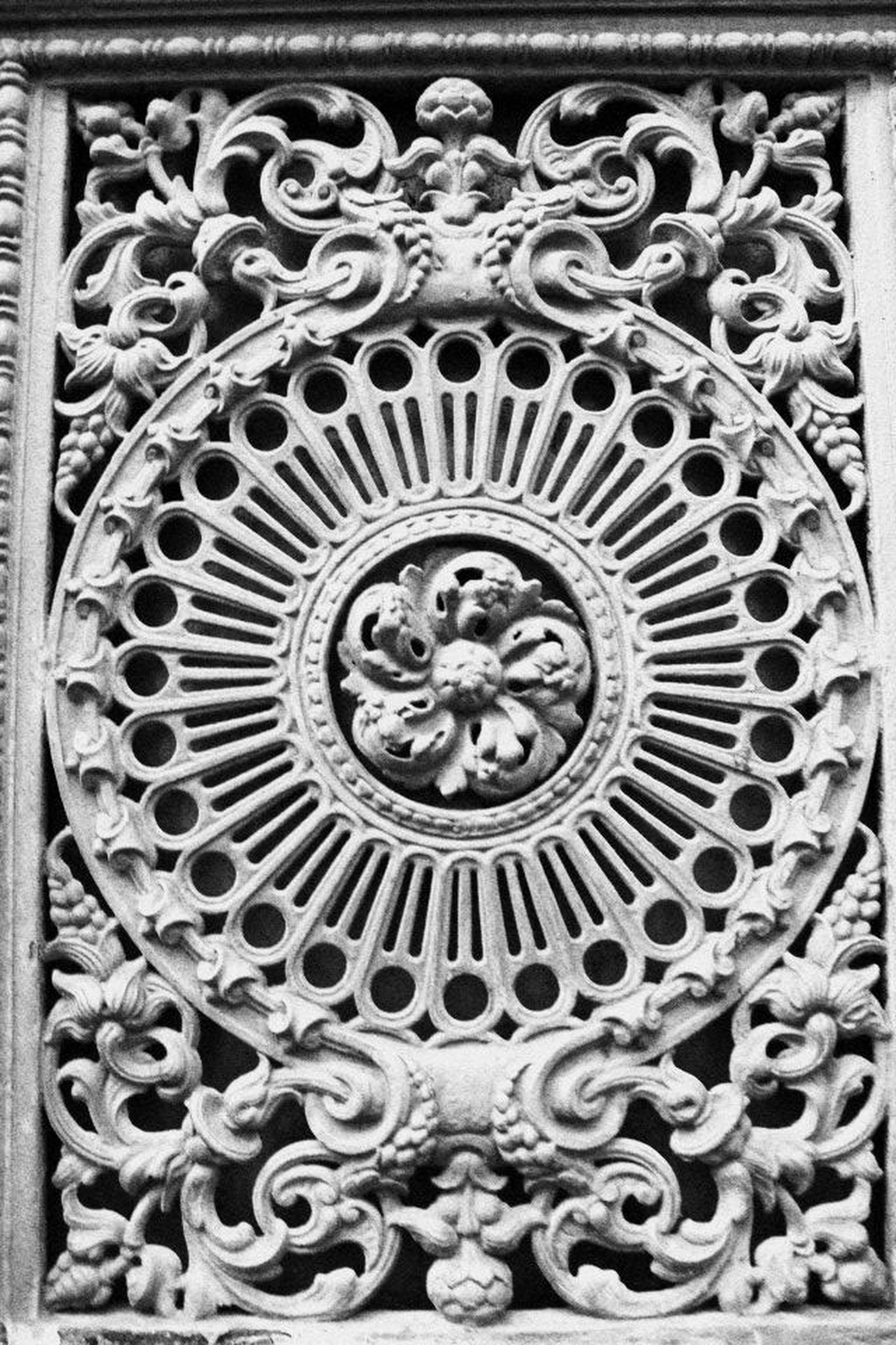 transfer print, art and craft, art, creativity, ornate, auto post production filter, carving - craft product, circle, human representation, indoors, sculpture, metal, close-up, design, pattern, old, statue, history, built structure