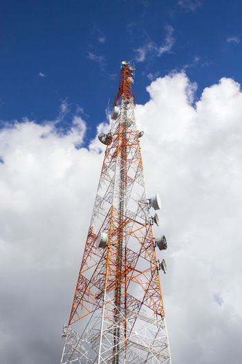 Antenna - Aerial Architecture Broadcasting Built Structure Cloud - Sky Communication Computer Network Connection Data Day Global Communications Industry Information Medium Low Angle View No People Outdoors Satellite Dish Sky Tall - High Technology Telecommunications Equipment Television Aerial Television Industry Tower Wireless Technology