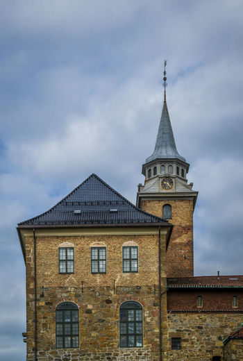 The Akershus Fortress, Oslo, Norway Akershus Norway Oslo, Norway Akershus Fortress, Architecture Building Exterior Built Structure Clock Clock Tower Cloud - Sky Day Landmark Low Angle View Nature No People Outdoors Roof Sky
