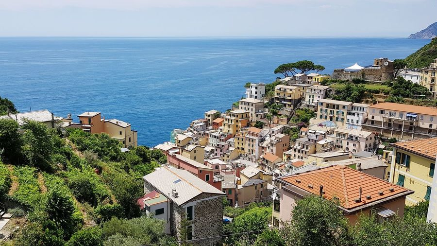 lovely Riomaggiore at Mediterranean coast Mediterranean  Coast Coastline Village Water Sea Tree Beach High Angle View Sky Horizon Over Water Architecture Building Exterior TOWNSCAPE Housing Settlement Town Place Cityscape Roof Rooftop Human Settlement Settlement Residential Structure