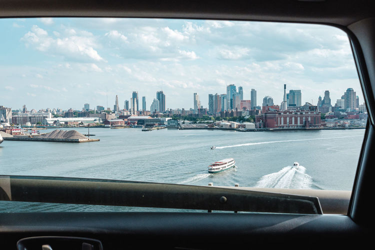 View of cityscape against sky seen from car