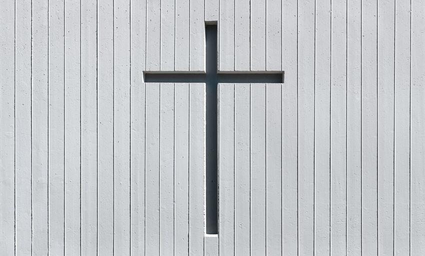 Full frame shot of religious cross on wall