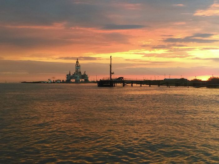 The Essence Of Summer Sunset In The Gulf Sunset_collection Summer Sky And Clouds Sihouettes Water Reflections Water_collection Islands Oil Rig In Background Brilliant Colors Gulf Of Mexico