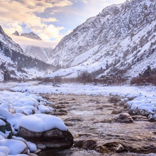 Ala Archa, Chui Valley in Kyrgyzstan, near China. The Tien Shan or heavenly mountains make a great backdrop for the beautiful snow. Snow Sunset Landscape Beauty In Nature No People Sky Cold Temperature Nature Tranquility Outdoors Cloud - Sky Tranquil Scene Scenics Mountain Water Day Miles Away