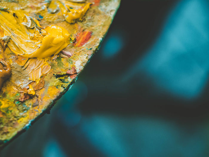 Close-up of yellow paints in palette