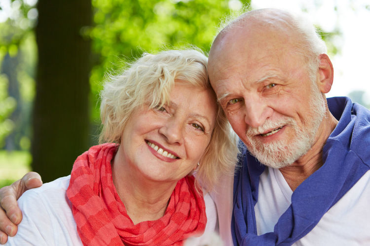 Close-Up Portrait Of Senior Couple At Park