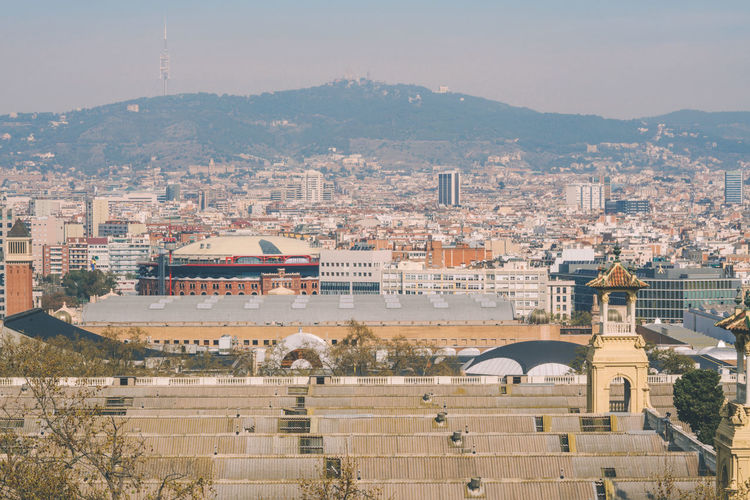 Observation platform with binoculars overlooking sagrada de familia in barcelona