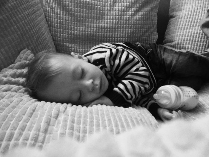 Close-up of baby boy sleeping in bed at home