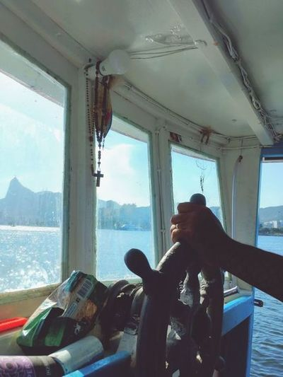 Deus me guia Boat Trip Fishing Boat Direction... Horizont  Eyeem Market Free Style Sea Life Seaview Rio De Janeiro Tourism Attraction UnderSea Human Hand Water Sea Scuba Diving Nautical Vessel Window Close-up Looking Through Window Window Sill