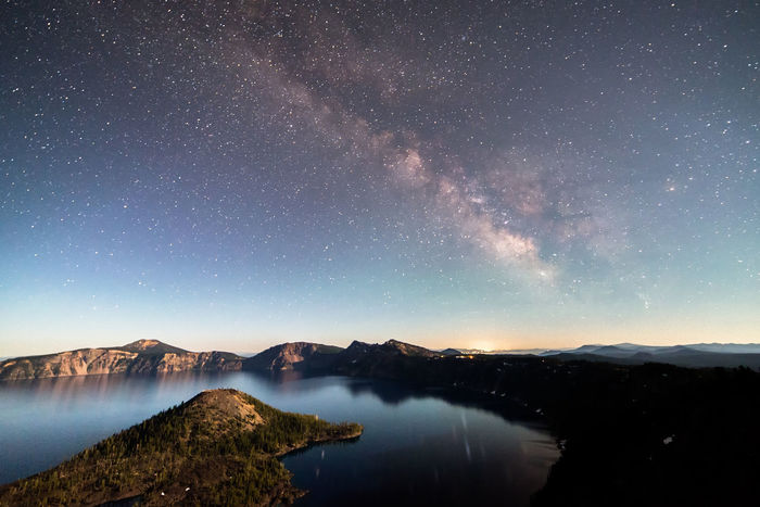 Crater Lake National Park Crater Lake National Park National Park Reflection Astronomy Astrophotography Beauty In Nature Constellation Galaxy Lake Milky Way Milky Way Galaxy Mountain Nature Night No People Outdoors Sky Space Star - Space Starry Starry Night Tranquil Scene Tranquility Tree Water EyeEmNewHere